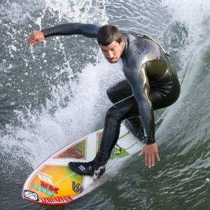 Surfer_at_the_Cayucos_Pier,_Cayucos,_CA